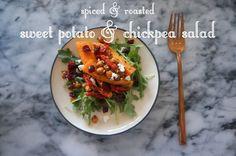 spiced & roasted sweet potato & chickpea salad - roasted sweet potato wedges and chickpeas seasoned with lots of pepper, cumin, cayenne, coriander, mustard, and nutmeg, assembled into a salad with arugula, sun dried tomatoes, crumbled feta, and dried cranberries