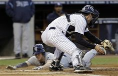GAME 31: Thursday, May 10, 2012 - Tampa Bay Rays' Elliot Johnson, left, is safe sliding home past New York Yankees catcher Chris Stewart during their baseball game at Yankee Stadium in New York. (AP Photo/Kathy Willens)