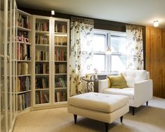 A cozy-looking reading nook. Love the contrast of wall to shelves. Chair looks really comfortable. From apartment therapy.