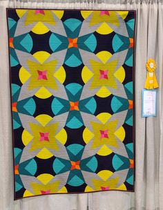 """""""Fireworks"""" by Jeannie Jenkins This unusual, bold color scheme was truly a showstopper in person. It won 2nd place in Modern Traditionalism @ Quilt Con 2017."""