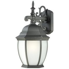 Covington 1x18W Outdoor Wall Lantern in Black by Thomas Lighting. $68.00. PL92297 Features: -One light wall lantern.-Etched glass.-Energy saving.-For outdoor use. Includes: -Photocell included. Color/Finish: -Black finish. Specifications: -Accommodates: (1) 18W GU24 fluorescent bulb. Dimensions: -Overall dimensions: 18'' H x 9.5'' W x 9.5'' D.