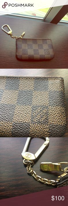 Authentic Louis Vuitton Key Pouch 100 percent authentic Louis Vuitton damier key Pouch. Logoed inside as well as classic Logoed hardware. Good used condition. Tarnishing of hardware on keyring. Louis Vuitton Accessories Key & Card Holders