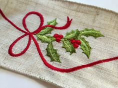 Holly and ribbon. Repinned by www.mygrowingtraditions.com