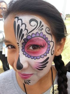 Half Sugar Skull also known as a Day of the Dead face paint by Cynnamon-Bay Area Party Ent.