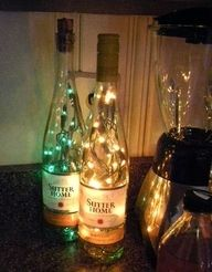 Battery operated fairylights in old wine bottles- a nice idea for outdoor centre pieces