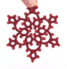 'Celyna' - one red beaded Christmas tree decoration in tatting lace.