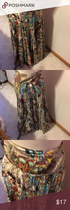 Skirt by biya This is a floor length skirt with very bold pattern to it it has a ruffled layers to it it's a size small with a hidden zipper in back its 100 % silk biya Skirts Maxi
