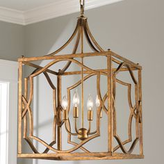"""A modern fretwork trellis frame in Antiqued Gold, Soft Gold, or Antique Silver adds Chippendale style from the foyer to the library. 4x60 watt max candle base sockets. (29""""Hx18""""W). Supplied with 10' of chain and 15' of cord. Canopy (1.25""""Hx5.4""""W)."""