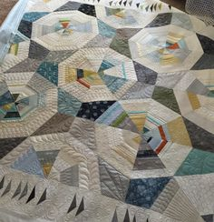 I recently quilted an Octagon Shimmer quilt for a local client. This pattern is designed by Jennifer Sampou. I emphasized the octagon shapes by randomly quilting designs in a radiating octagon. I used a Mark B Gone pen to draw boundary lines and then quilted in between with varying designs. I would suggest using a size… Read More