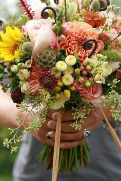 Hand Tied Bouquet With Lots Of Ingredients! Coral Dahlias, Light Pink Roses, Yellow Button Mums, Yellow Sunflower, Pink Hypericum Berries, Fern Shoots, Scabiosa Pods, Green Trick, Pink Gerber Daisies, & Foliage>>>>