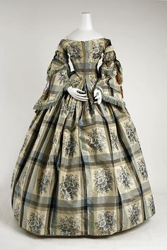 http://www.metmuseum.org/  Date: 1856–57 Culture: American Medium: silk, cotton Dimensions: (a) Length at CB: 18 3/4 in. (47.6 cm) (b) Length: 44 in. (111.8 cm) (c) Length at CB: 13 1/2 in. (34.3 cm) (d, e) Length: 19 in. (48.3 cm) Credit Line: Gift of Mrs. Henry William Walker, 1958 Accession Number: C.I.58.9.1a–e