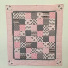 Baby Quilt size: 37 x 40 1/2 This Modern Print baby girl quilt is perfect for the crib, stroller, car seat, and for a toddler to carry around and cuddle with. It also would make a wonderful baby shower gift for a special Mother to be on your shopping list. My Baby Quilts are sewn with special care. I machine pieced the quilt with squares of gray Elephants and assorted gray and white Modern prints using 100% cotton fabrics, then layered it with polyester low loft batting for... Baby Girl Quilts, Girls Quilts, Baby Quilt Size, Straight Line Quilting, Handmade Baby Quilts, Toddler Stuff, Grey Elephant, Quilt Sizes, Baby Prints