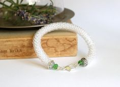 Bead crochet rope bracelet in clear glass and green by BibaStore on Etsy