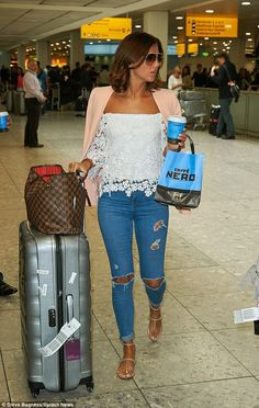 Lucy Mecklenburgh looks chic in a peach blazer, lace top and distressed jeans as she arrives back in London after LA break | Daily Mail Online