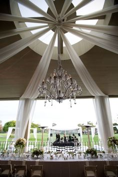 LOVE this tent... and the chandelier is a must!