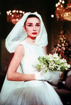 Audrey Hepburn photographed in her quintessential Givenchy wedding dress for the movie Funny Face, 1956.