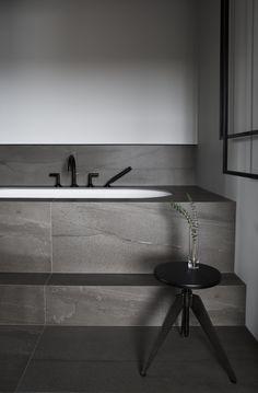Masculine bathroom. Roman tub with matt black Kholer taps and large Iris Ceramica tiles. Styled with Pols Potten stool. Designed by Sæja interior Designer