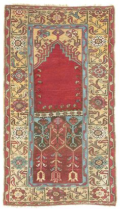 LÂDÍK prayer rug, ca. 1850.  The complex, free-form pattern beneath the prayer arch incorporates ancient latch hook motifs with stylized tulips, descending as if from heaven to the earth.  183 x 101.5 cm.