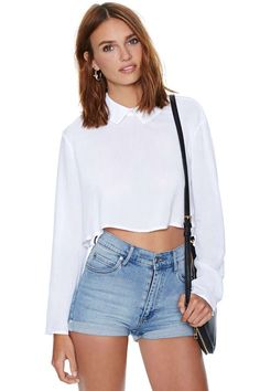 We took your basic white blouse and turned it up a notch (because that's just how we roll!).