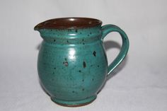 Teal Blue Pottery Pitcher Speckled Vintage Stonewear Hand thrown. $38.00, via Etsy.