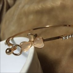 Gold plated, lucky clover bangle, new, never worn. Gold plated, lucky clover bangle, new, never worn, free allergic. Jewelry Bracelets