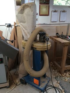 An unexpected wind fall. I was given an extractor. One change of hose and it's now hooked up to the planer thicknesser.