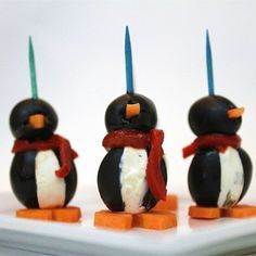 """Cream Cheese Penguins I """"Stuffed olives with cream cheese has always been a favorite of mine but I would never have thought to shape them like a penguin. CUTE!"""""""