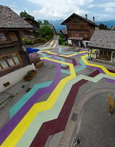 They actually did this in Switzerland.  Great way to give a new life to tired cement walkways.