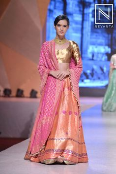 Look pretty in this #pink choli and dual shaded #lehenga, paired with a golden shimmery blouse