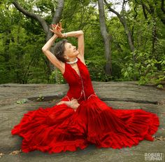 Oldest living yoga teacher and she's 93 years young. Love the red dress. Fabulous!