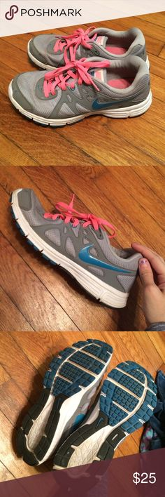 Nike Revolution 2 Grey Nike tennis shoes with blue and pink accents. In good condition. Nike Shoes Sneakers