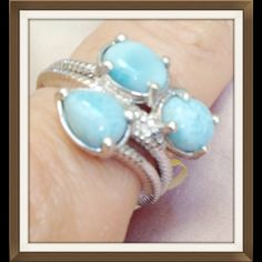 Larimar Ring TGW 3.90 Cts  (Size 7 or 8) NEW Genuine Larimar Ring in Platinum Overlay .925 Sterling Silver Nickel Free (Size 8) TGW 3.90 Cts.  One in size 7 also available. Beautiful by pass setting. This is a 100% natural gemstone found in only one place on earth, a very tiny mine in the Dominican Republic, which is virtually mined out. Comment to me with the size you want and I will create a separate listing. Jewelry