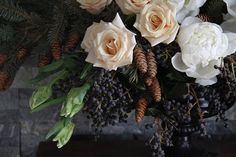 Pinecone, peony and tulip centerpiece by Sarah Winward