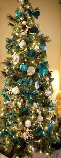 Peacock Blue & ivory decorations on this Christmas tree: