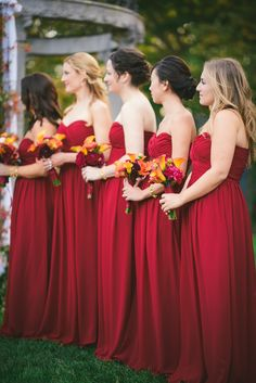 Monique Lhuillier Bridesmaids Dresses - Stunning deep red color. See the #fall wedding here: http://www.StyleMePretty.com/2014/05/27/art-deco-inspired-wedding/  #SMP -- Photography: KateIgnatowski.com