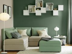 A Small Livingroom Furnished With Three Seat Corner Sofa Combination In Green And Beige That Can Be Converted Into Bed Combined