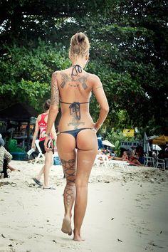 "Loving the ""Corset Piercing"" tattoo on her left leg <3    I do love it tooo.!!"