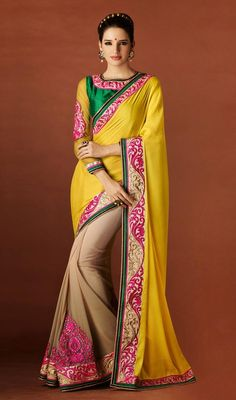 Take your graceful style a few notches up dressed in this beige and yellow shade jacquard half n half saree. The ethnic butta, lace, resham and stones work with a saree adds a sign of elegance statement with a look. #StunningEveningSareeCollection