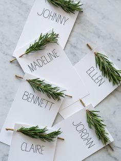 i love the simplicity of these name plates. adjust the adornment to the season. a little flower for spring? rosemary or lavender for summer? //For Your Holiday Table This Year: Rosemary Sprig Place Cards