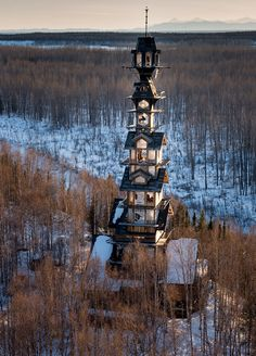 alaskan attorney builds 185 foot stacked log cabin tower in the wilderness