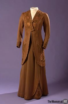 Suit  Medium: Brown cotton sateen, cotton floss, soutache cord, and tape  Date: c.1913  Country: USA