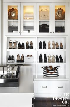 Amazing walk-in closet built-in cabinets with custom lighting showcasing designer bags finished with glass-front doors stacked over shoe shelves and storage drawers. -- Want additional info? Click on the image. #easyhomedecorideas