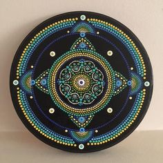 This is a dot art mandala painted on an 8 pine round using acrylic paint. It is sealed with a semi-gloss clear coat varnish. My mandalas are all created intuitively. This is a one-of-a-kind original. No prints will be made from it and it cannot be duplicated. It can be used as wall