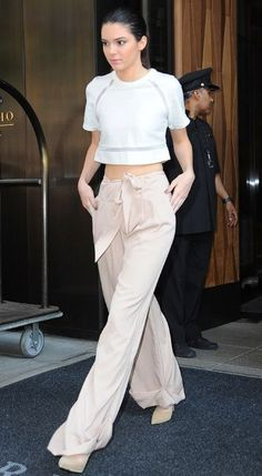 looking for a similar white crop top and the beige pants that Kendall Jenner is wearing