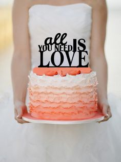 Love is all you need: | 21 Adorably Unusual Wedding Cake Toppers