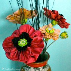 Soft sculpture fabric flower poppies in a vase. Easy kanzashi flower pattern has 2 sizes, plus buds. Make great fabric flower headbands as well.