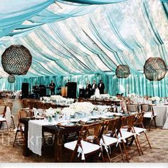 Love the blue coming down from the tent. Also like the dark wood chairs.