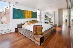 Love the juxtaposition of the rustic bed with the contemporary interior.