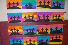 Water color background and cut out crosses from black paper | Easter week crafts an activities for preschool