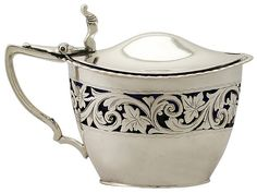 'Silver Mustard Pot'   A fine and impressive antique Victorian English sterling silver mustard pot.
